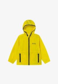 BOSS Kidswear - WINDBREAKER - Chaqueta de entretiempo - yellow - 3