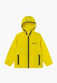 BOSS Kidswear - WINDBREAKER - Chaqueta de entretiempo - yellow - 0