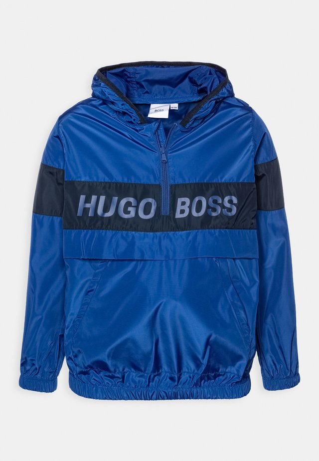 HOODED WINDBREAKER - Veste imperméable - blue