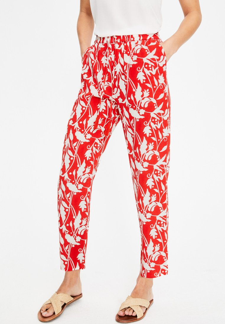 Boden - Stoffhose - bright red, jungle palms