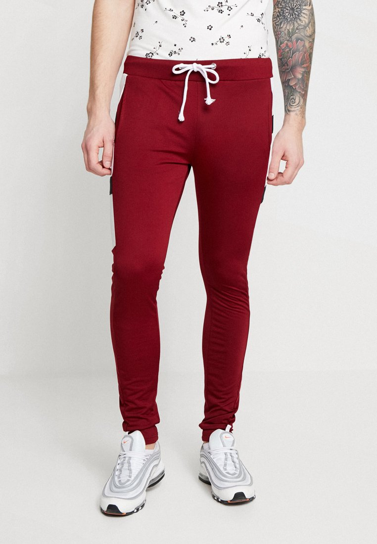 boohoo MAN - COLOUR BLOCK JOGGERS - Pantalon de survêtement - burgundy