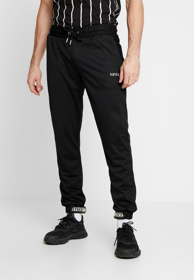 MAN AIRTEX  WITH RUBBER TAB - Pantaloni sportivi - black