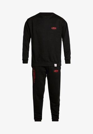 MAN OVERSIZED - Spodnie treningowe - black