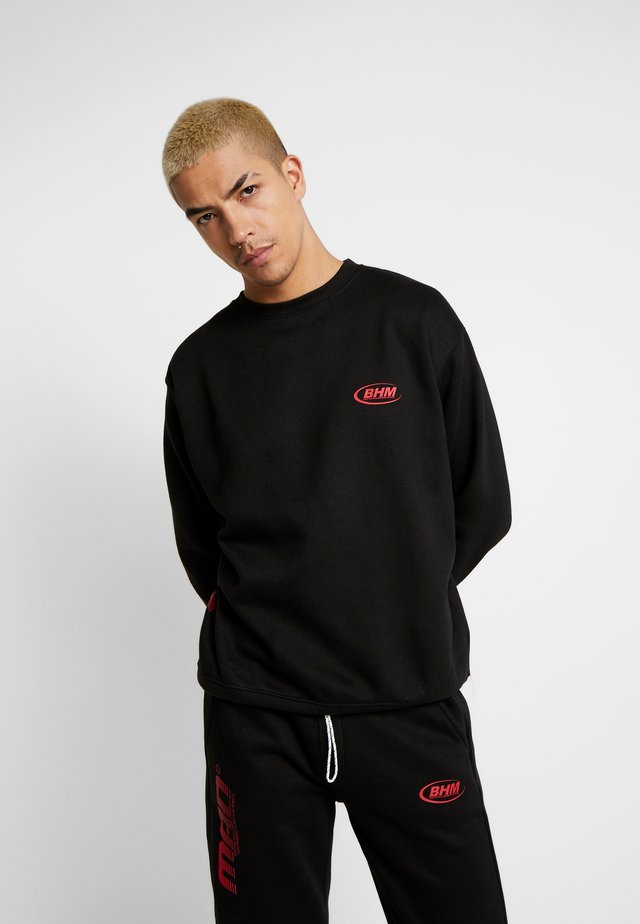 MAN OVERSIZED - Jogginghose - black