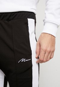 boohoo MAN - TRICOT WITH SIDE PANEL - Tracksuit bottoms - black - 5