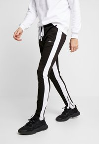 boohoo MAN - TRICOT WITH SIDE PANEL - Tracksuit bottoms - black - 0