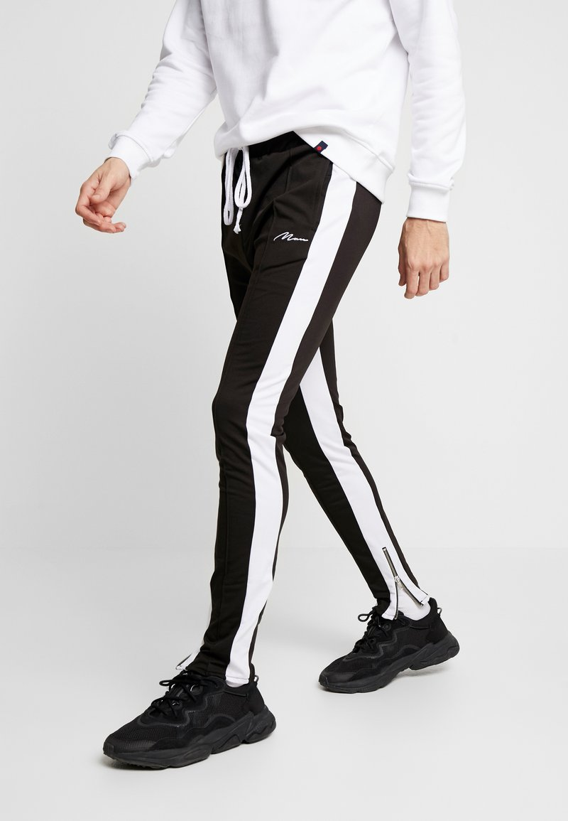 boohoo MAN - TRICOT WITH SIDE PANEL - Tracksuit bottoms - black