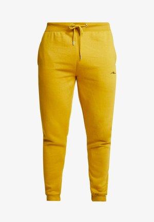 Pantalones deportivos - mustard