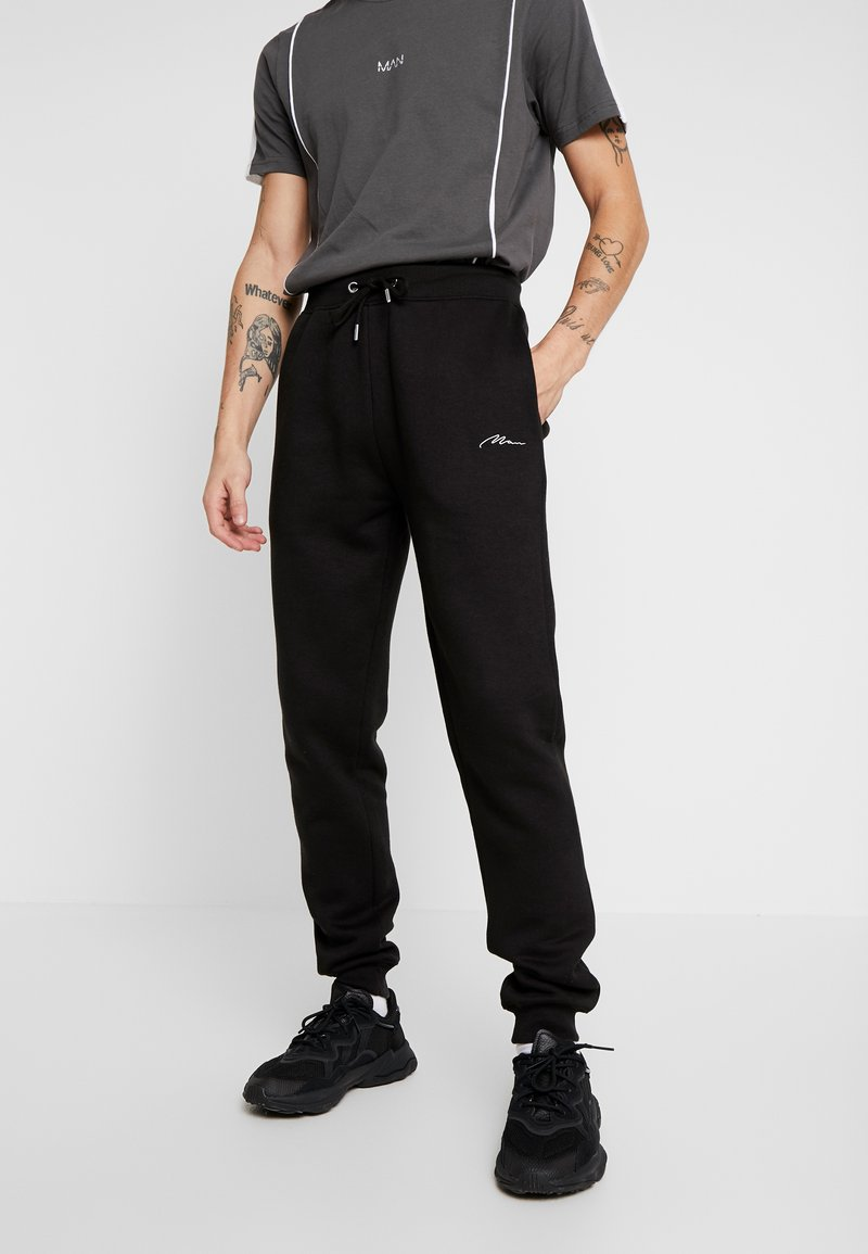 boohoo MAN - Jogginghose - black
