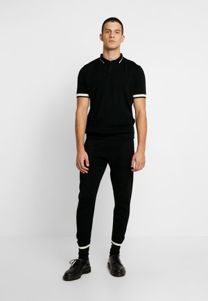 REGULAR FIT SET - Tracksuit bottoms - black