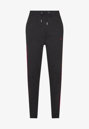 MAN SIGNATURE SKINNY FIT - Pantalones deportivos - black