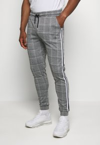 boohoo MAN - SIGNATURE CUFFED JOGGER WITH TAPE - Trousers - grey - 0