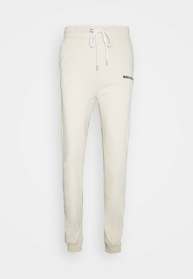 MAN OFFICIAL HEAVYWEIGHT JOGGER - Pantaloni sportivi - off white
