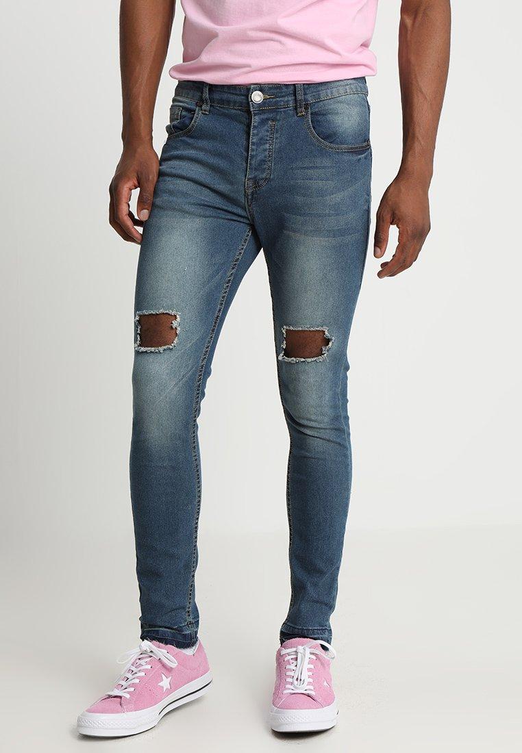 Knee Skinny And Man Blue Distressed Boohoo HemJeans SVqMpUz
