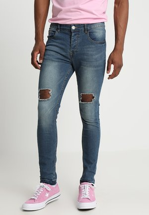 DISTRESSED KNEE AND HEM - Jeans Skinny Fit - blue