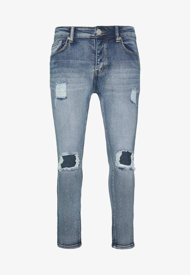 SUPER BUSTED KNEE DISTRESSING - Jeans Skinny Fit - denim light blue wash