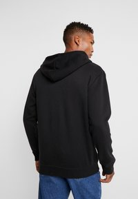 boohoo MAN - MAN AESTHETICS HEAVYWEIGHT LONGLINE ZIP THROUGH - Sudadera con cremallera - black - 2