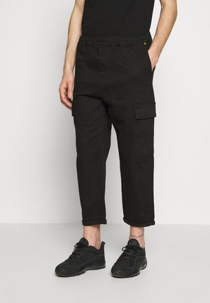 TRACK  - Cargo trousers - black