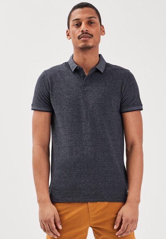 INSTINKT  - Poloshirt - bleu foncé