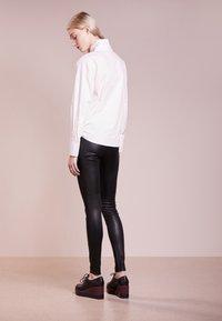 Bruuns Bazaar - CHRISSY  - Leather trousers - black - 2
