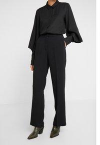 Bruuns Bazaar - VALOVA MANELLE PANT - Spodnie materiałowe - black - 0