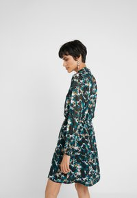 Bruuns Bazaar - BOTANIC LUCINDA DRESS - Day dress - black/deep green artwork