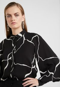 Bruuns Bazaar - BONNE ABSTRACT SHIRT - Button-down blouse - black - 4
