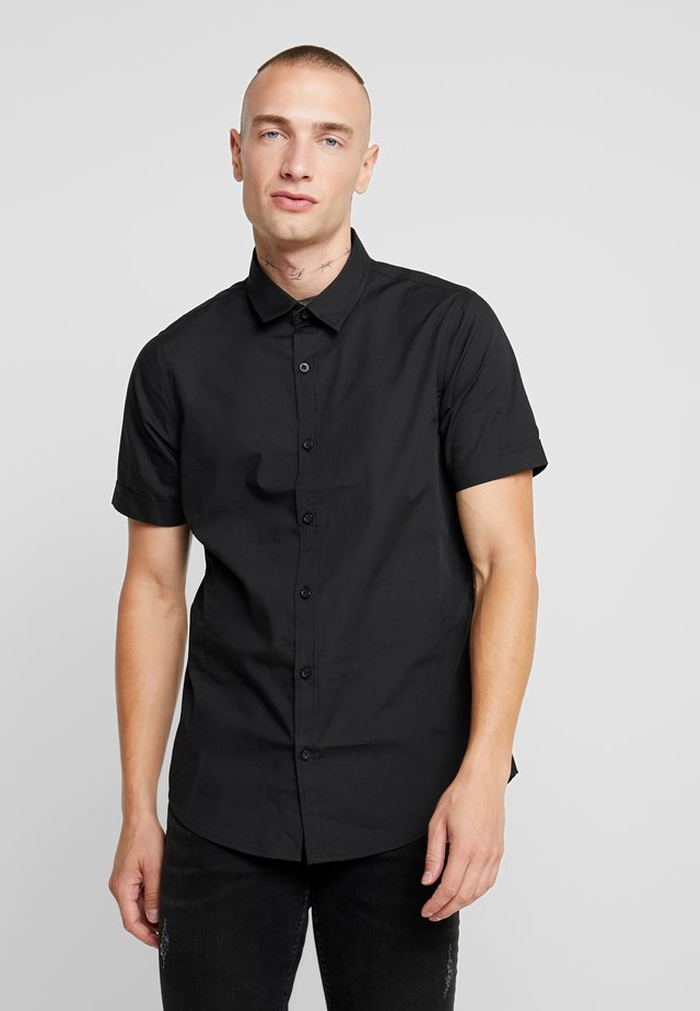 MOMBASSA - Shirt - black