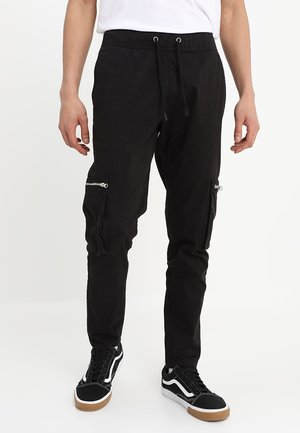 ASTRID - Cargo trousers - black