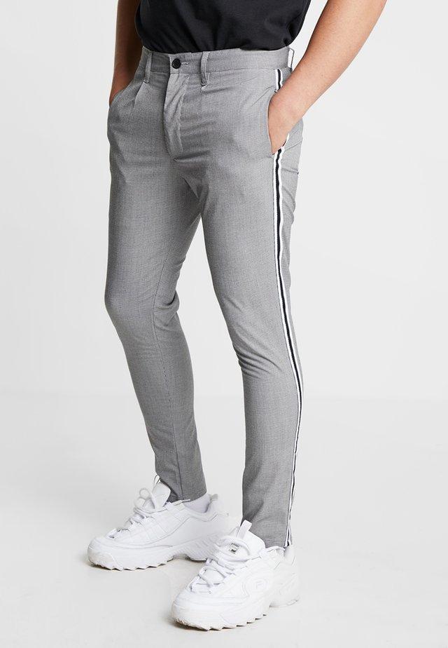 STERLING - Kalhoty - black/white