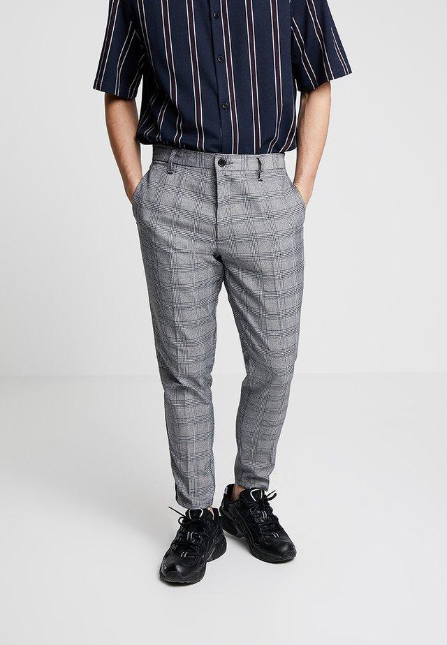 THOMAS - Spodnie materiałowe - black/white