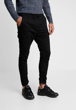 HADDON - Cargo trousers - black