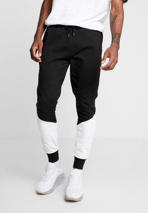 SUNNY - Tracksuit bottoms - black/ white
