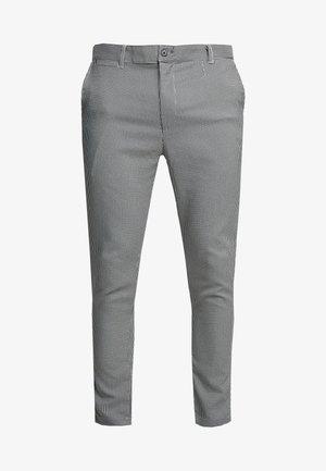 ALBERT - Trousers - black/cream