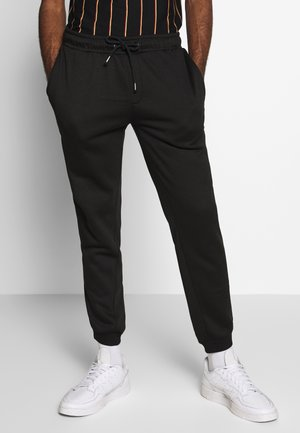 STEING - Trainingsbroek - black