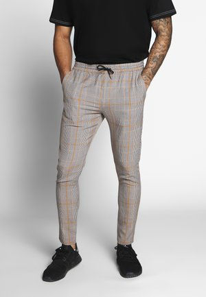 ADAM - Trousers - brown/orange