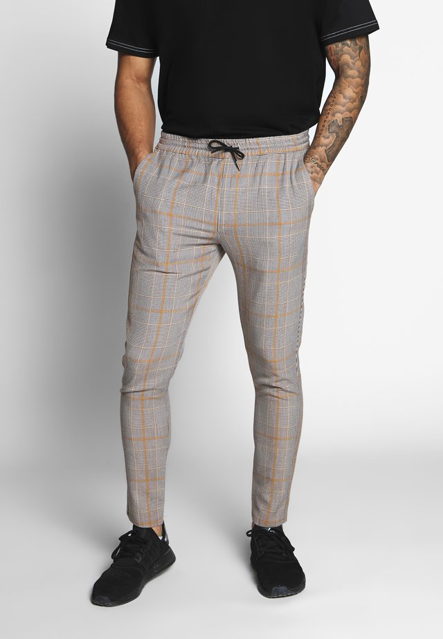 ADAM - Pantalon classique - brown/orange