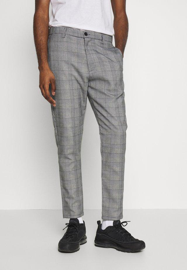 TOM - Spodnie materiałowe - black/white