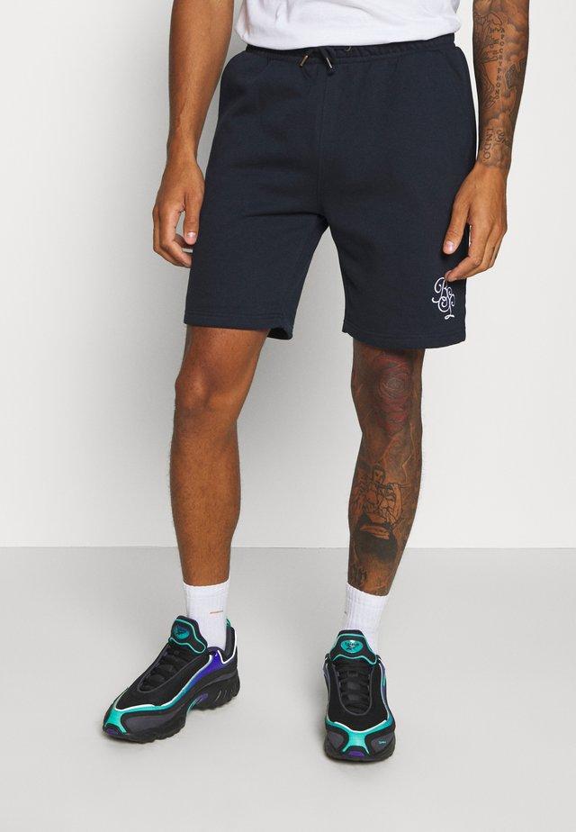 TRISTAN - Spodnie treningowe - rich navy
