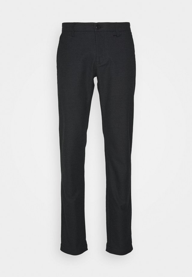 RUSSELL - Trousers - black