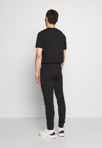 Bricktown - PANTS CIGARETTE - Tracksuit bottoms - black - 2