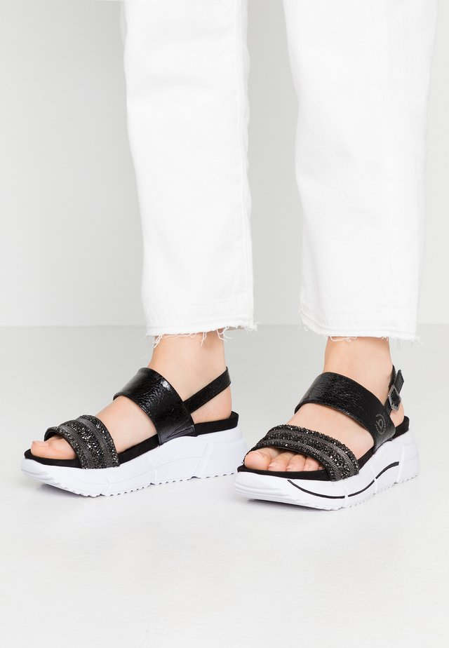RAJA - Korkeakorkoiset sandaalit - black/metallics