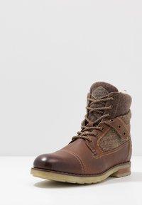 Bugatti - SUB EVO - Lace-up ankle boots - dark brown - 2