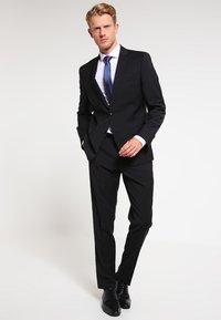 Bugatti - Oblekové kalhoty - black - 1