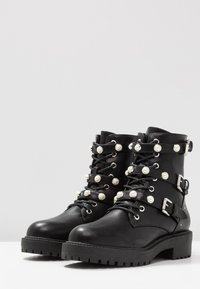 Bullboxer - Cowboy/biker ankle boot - black