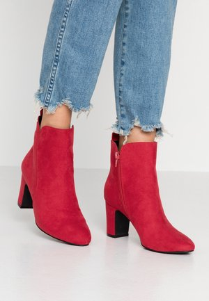 Ankle boots - berry