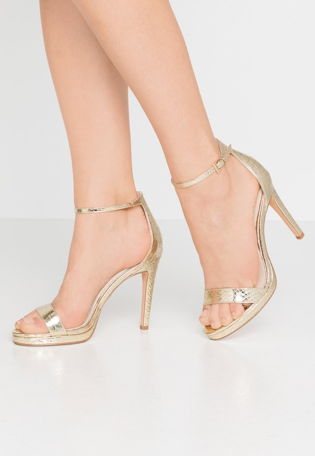 JANNA - Sandály na vysokém podpatku - gold