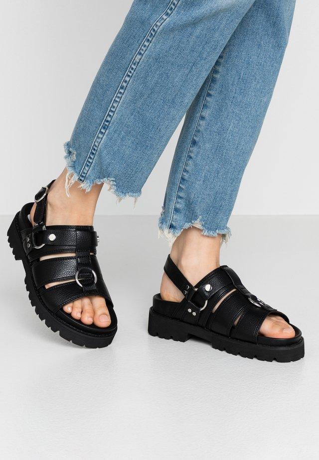 JUNO - Sandaalit nilkkaremmillä - black