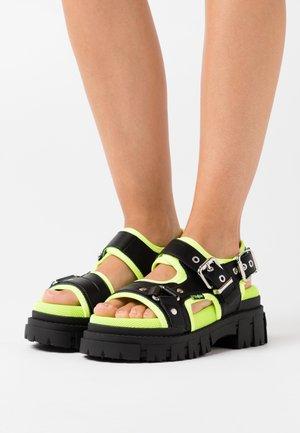 JORJA - Platform sandals - black/neon