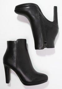 Buffalo - Kotníková obuv na vysokém podpatku - black - 1